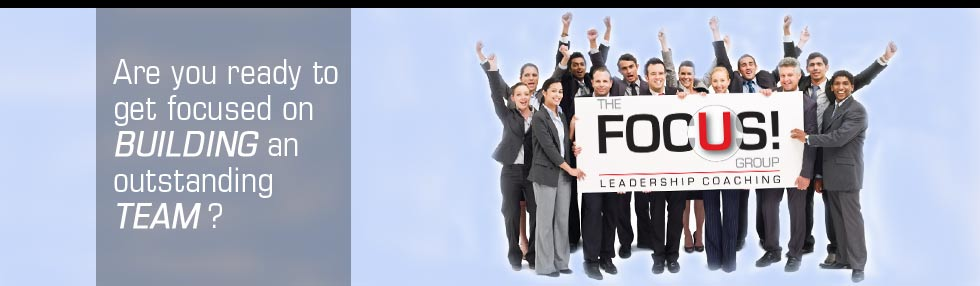 A group of business people holding a sign.